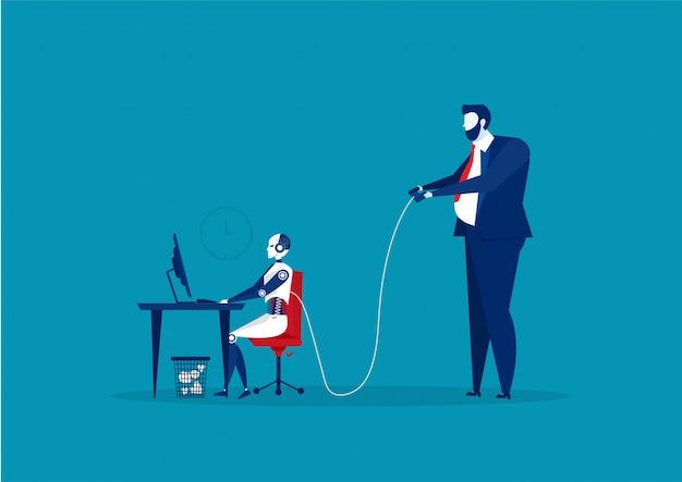 オフィスの机でロボットを制御するビジネスマン