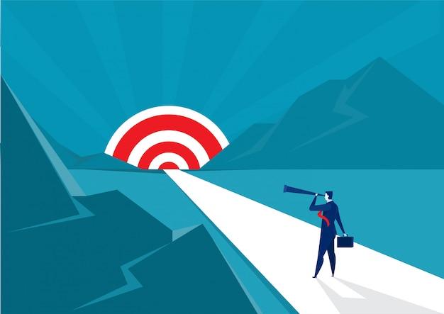 Видение направления бизнесмена в телескоп идти к цели для успеха