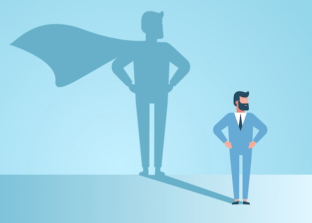 Businessman dreams of becoming a superhero. confident handsome young businessman standing superhero shadow concept illustration