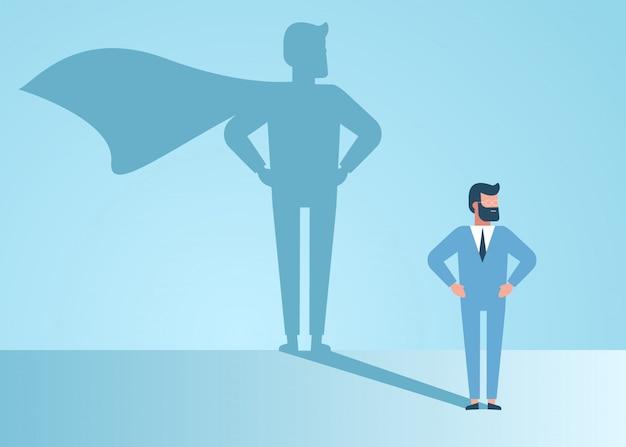 사업가 슈퍼 히어로의 꿈. 자신감이 잘 생긴 젊은 사업가 서 슈퍼 히어로 그림자 개념 그림