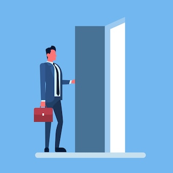 Businessman enter open door concept