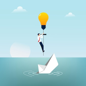 Businessman escapes from sinking paper boat by light bulb symbol