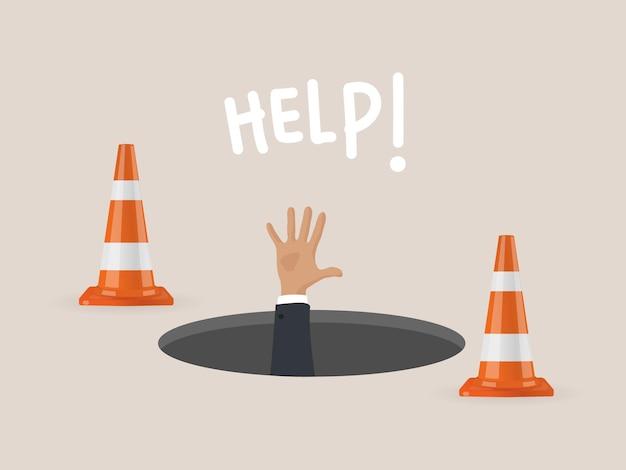 穴に落ちたビジネスマンは助けを求めています