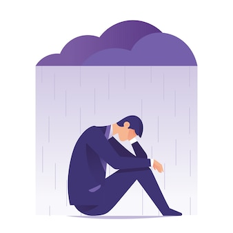 Businessman feeling sad and depression sitting under rain and cloud