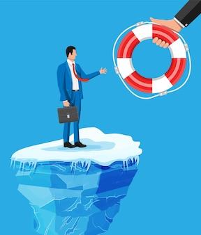 Businessman floats on iceberg getting lifebuoy.