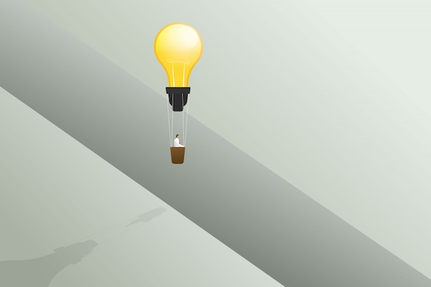 Businessman flying with lightbulb balloon cross edge of gap and business solution, creative idea concept