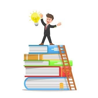 Businessman gets a bright light bulb after climbing a pile of books