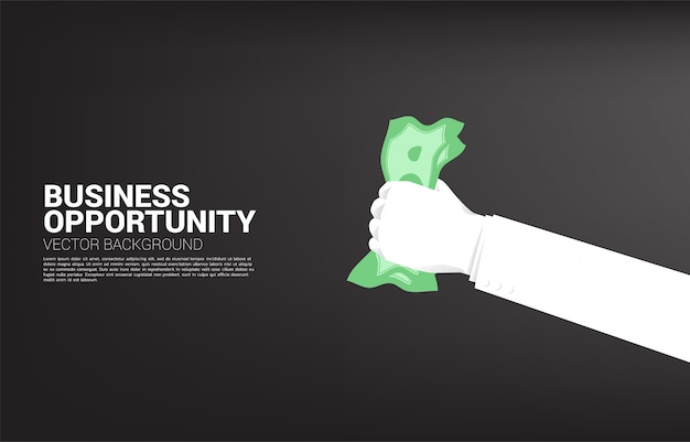Businessman hand grabbing money. concept for business opportunity and economy