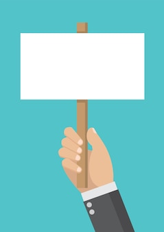 Businessman hand holding blank protest board.