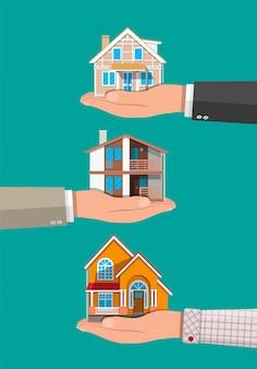 사업가 손 잡고 집. 부동산