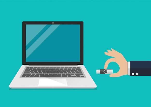 Businessman hand holding usb flash drive to connect a computer laptop