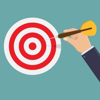 Businessman hand shooting target board