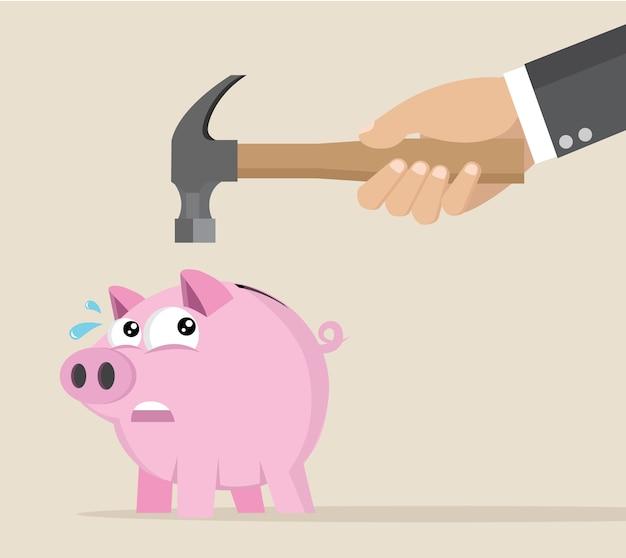 Businessman hand trying to brake pink piggy bank.