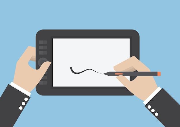 사업가 손 그래픽 태블릿에 그리기