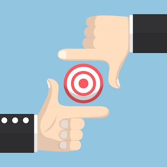Businessman hands forming a frame and focus on target