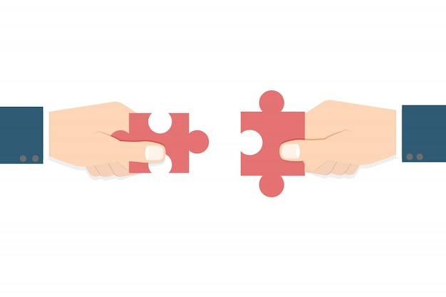 Businessman hands  holding puzzle. teamwork concept.
