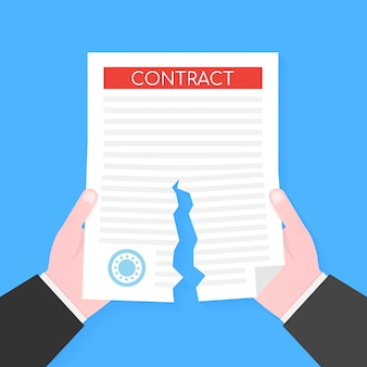 Businessman hands tearing apart contract document.  .