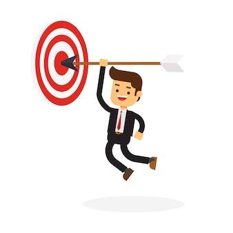 Businessman hanging arrow on target