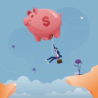 崖ビジネス貯蓄概念全体で大きな貯金バルーンにぶら下がっているビジネスマン