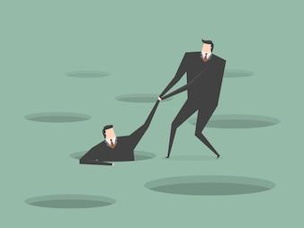 Businessman helping another businessman