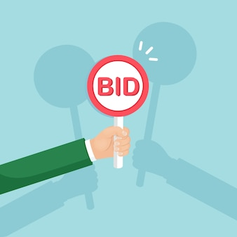 Businessman hold auction paddle in hand. bidding, auction competition concept. people rise signs with bid inscriptions. business trade process.