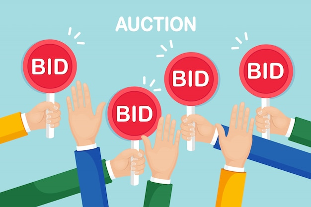 Businessman hold auction paddle in hand. bidding, auction competition concept.