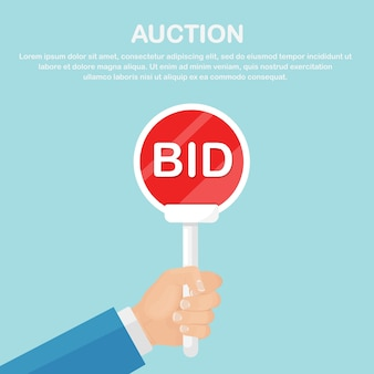 Businessman hold auction paddle in hand. bidding concept. people rise signs with bid inscriptions