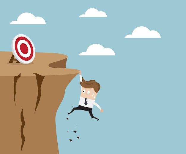 Businessman hold on the cliff for target