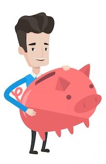 Businessman holding a big piggy bank.
