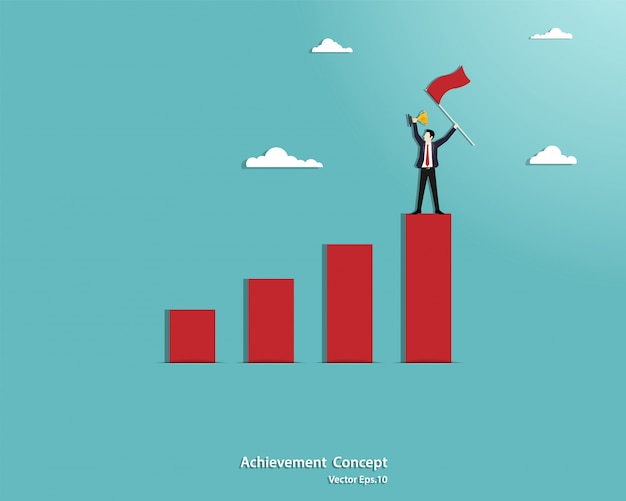 Businessman holding the flag and standing on the top of red graph