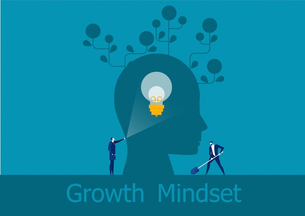 Businessman holding flashlight emits brain growth mindset positive concept