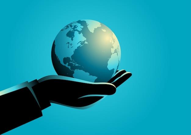 Businessman holding globe on his hand