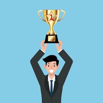Businessman holding gold trophy