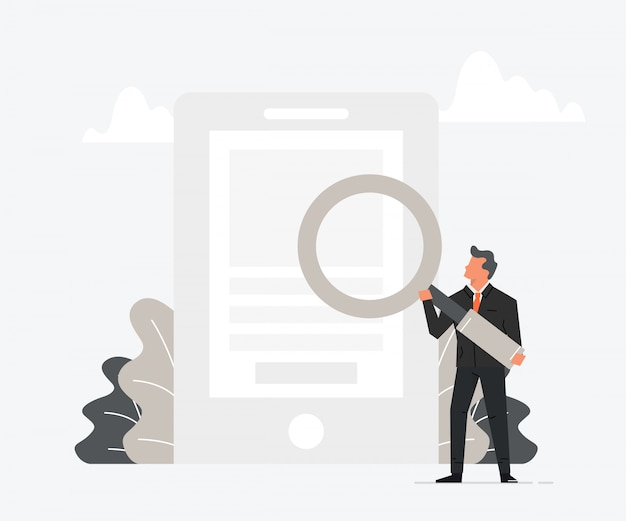 Businessman holding magnifying glass over phone.