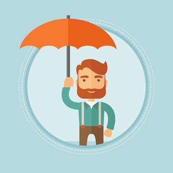 Businessman holding umbrella