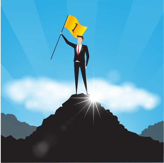 Businessman holds a golden flag on top of a mountain.