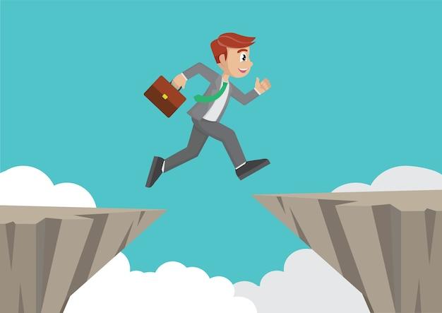 Businessman jump over cliff gap.
