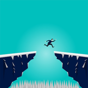 Businessman jump over cliff mountain gap