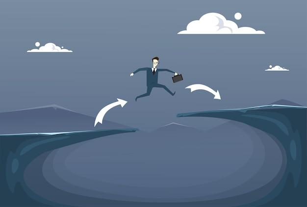 ビジネスマン、崖の上を飛ぶ
