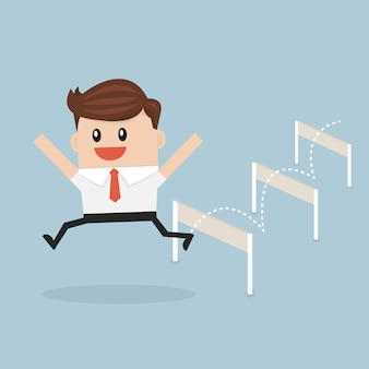 Businessman jumping over hurdle.