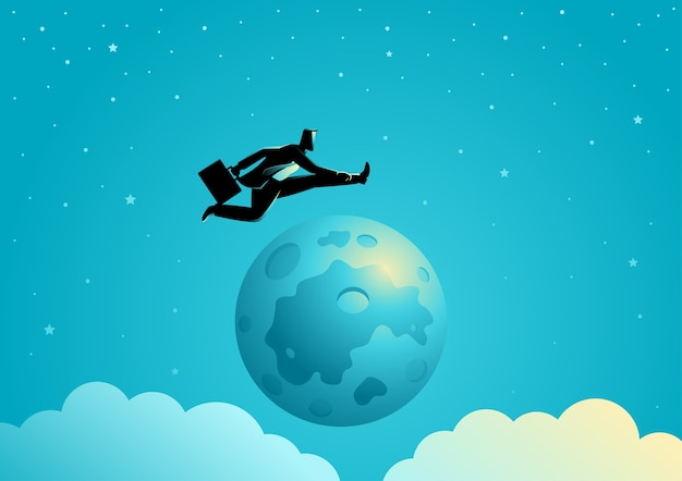 Businessman jumping over the moon