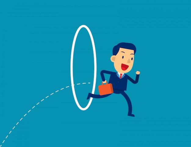 Businessman jumping through hoop.