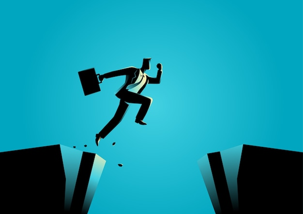 Businessman jumps over the ravine