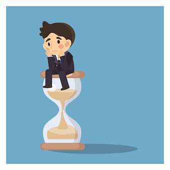 Businessman keep sitting and waiting on a hourglass