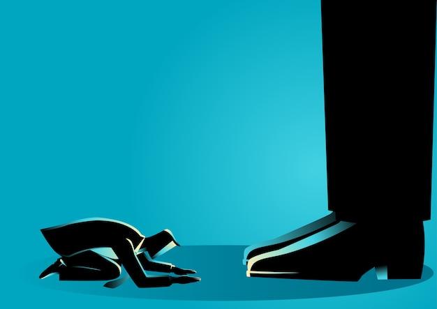 Businessman kneel down under giant feet