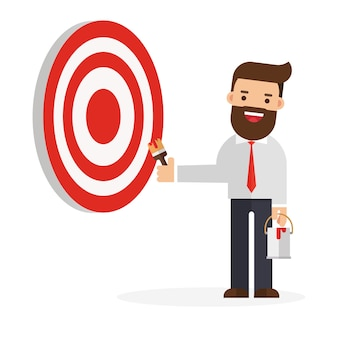 Businessman on ladder painting big business target goal