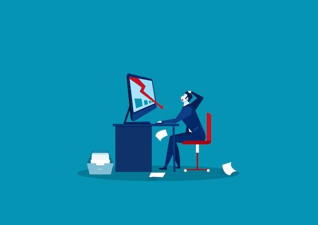 Бизнесмен смотря падая диаграмму на портативном компьютере