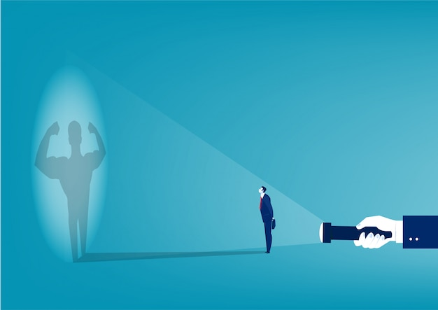 Businessman looking at his own strong personality shadow from flashlight concept vector