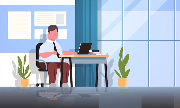 Businessman manager using laptop fatty  business man worker sitting workplace obesity concept
