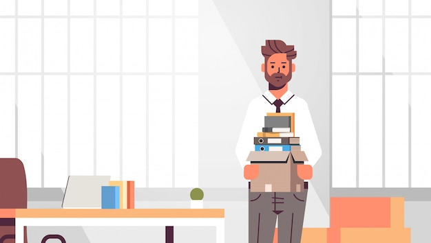 Businessman office worker holding box with stuff things new job business creative workplace modern office interior closeup